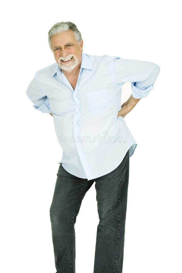 Alter Mann mit den rückseitigen Schmerz lizenzfreie stockfotografie