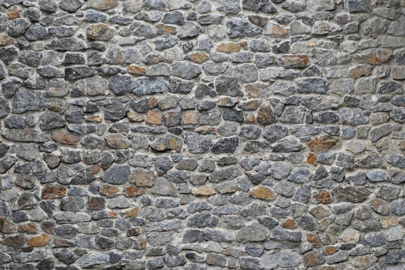 Alter Stein überlagerte Wand stockfotografie