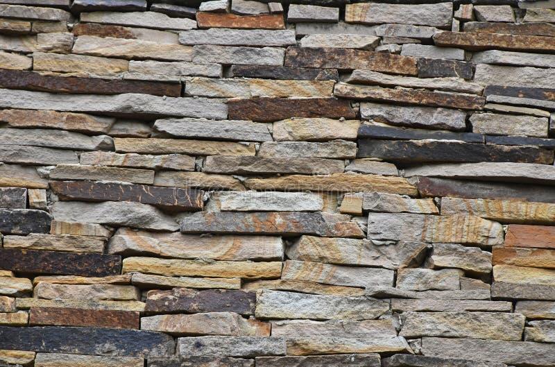 Alter Stein überlagerte Wand stockfotos