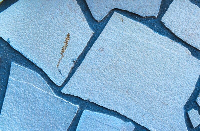 Alter Stein gelegt in das Wand, interessante und ursprüngliche backgroun lizenzfreie stockfotos