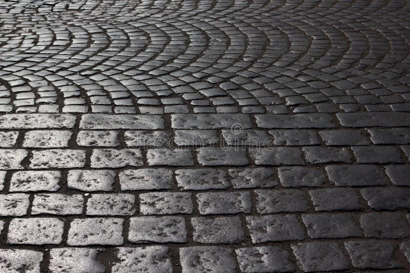 Alter Straßenkopfstein stockbilder