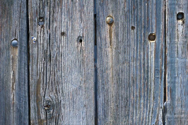 Alter verwitterter Bretterzaun blau befleckt lizenzfreie stockfotos