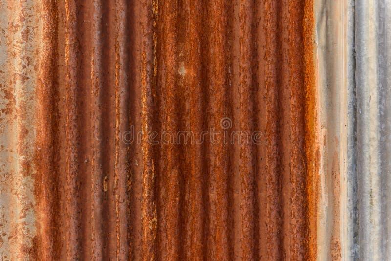 Alter Zinkwandoberflächenzaunhaus-Zinkhintergrund lizenzfreies stockbild