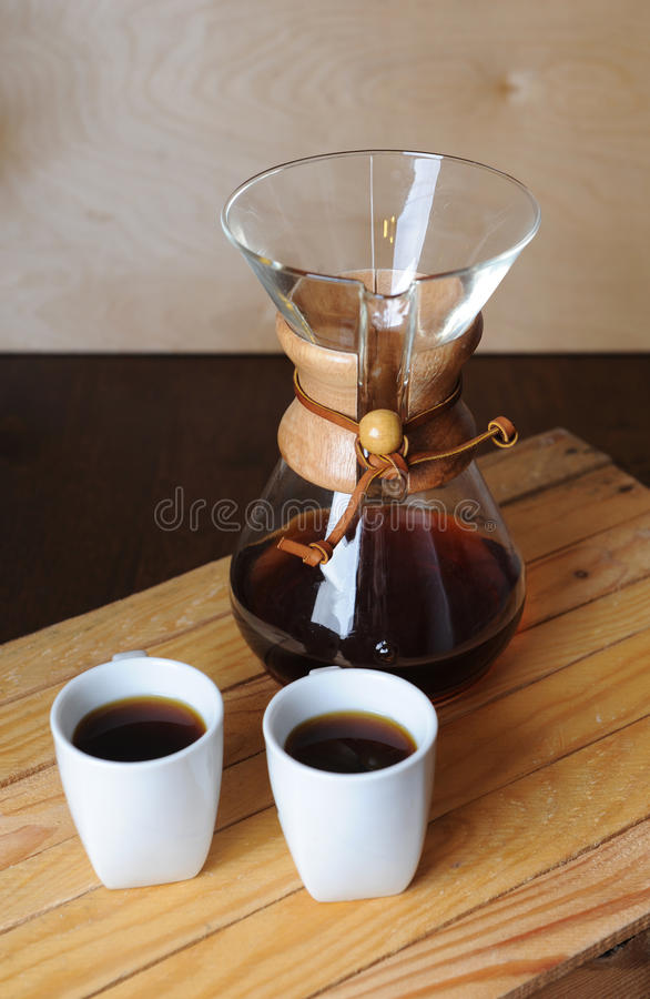 Alternate coffee brewing with a filter. Rustic background, white cups. Alternate coffee brewing with filter. Rustic background, white cups stock photo