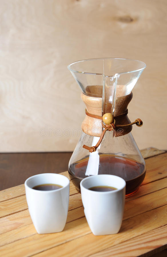 Alternate coffee brewing with a filter. Rustic background, white cups. Alternate coffee brewing with filter. Rustic background, white cups royalty free stock photo