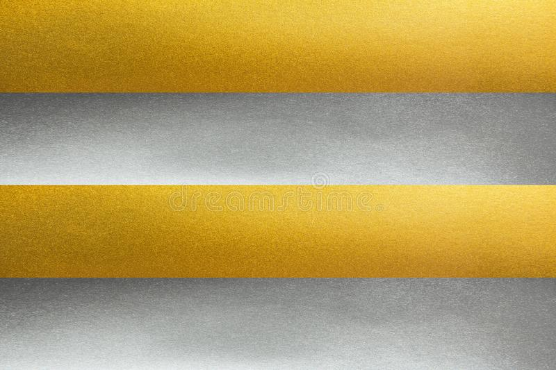 Lines gold and silver texture background.Row of gold and silver texture. Alternate horizontal lines gold and silver texture background. Horizontal row of gold stock images