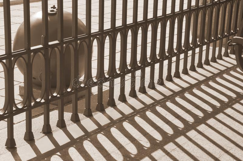 The alternation of light and dark bands in the militar museum. The shadow of the fence. Rhytm of shadows. The alternation of light and dark bands. The shadow of royalty free stock image