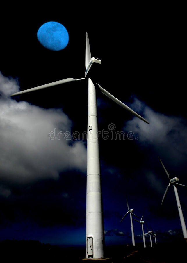 Alternative. Giant energy wind turbines and the moon royalty free stock photo