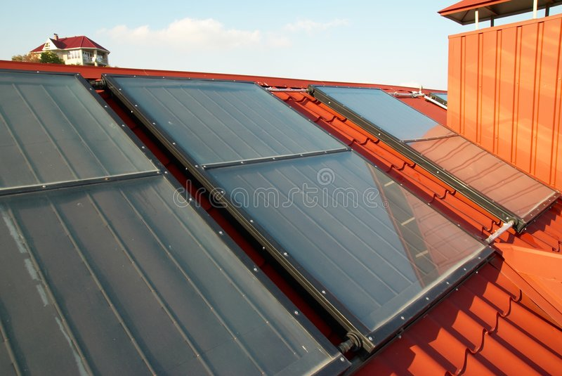 Alternative energy- solar system. On the house roof stock images