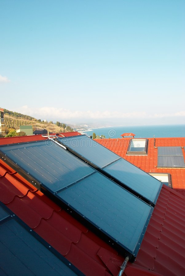 Alternative energy- solar system. On the house roof stock photo
