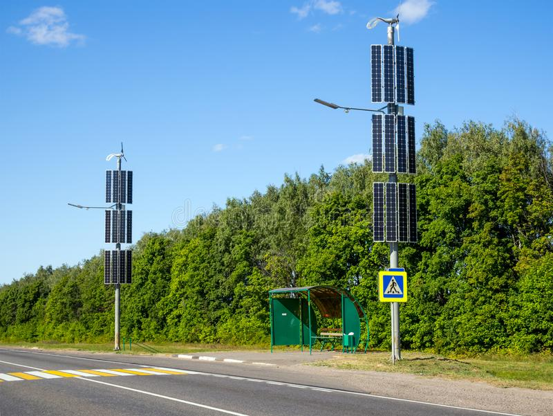 Alternative energy sources for lighting the bus stop on the highway.  stock photography