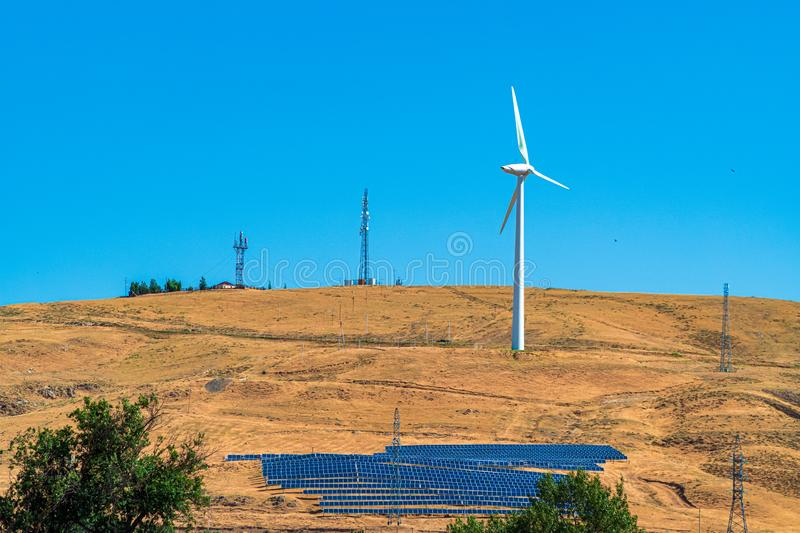 Alternative energy sources, wind turbine and solar panels stock photo