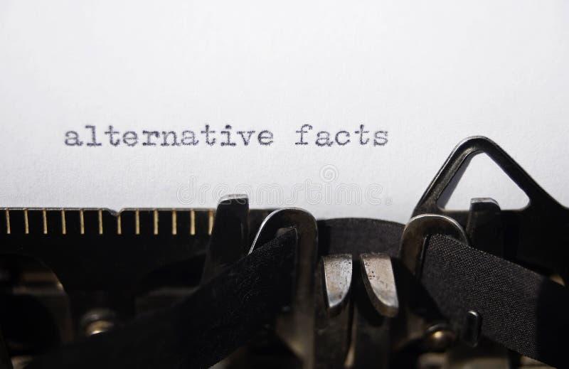 Alternative facts. On old typewriter stock photo