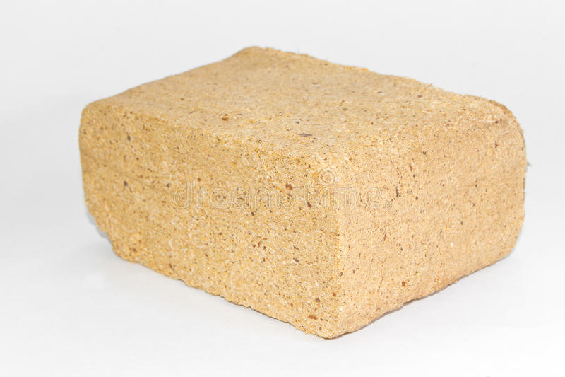 Alternative fuel, eco fuel, bio fuel. Wood sawdust briquettes for stoves. Lean-burn with good heat output. stock photos