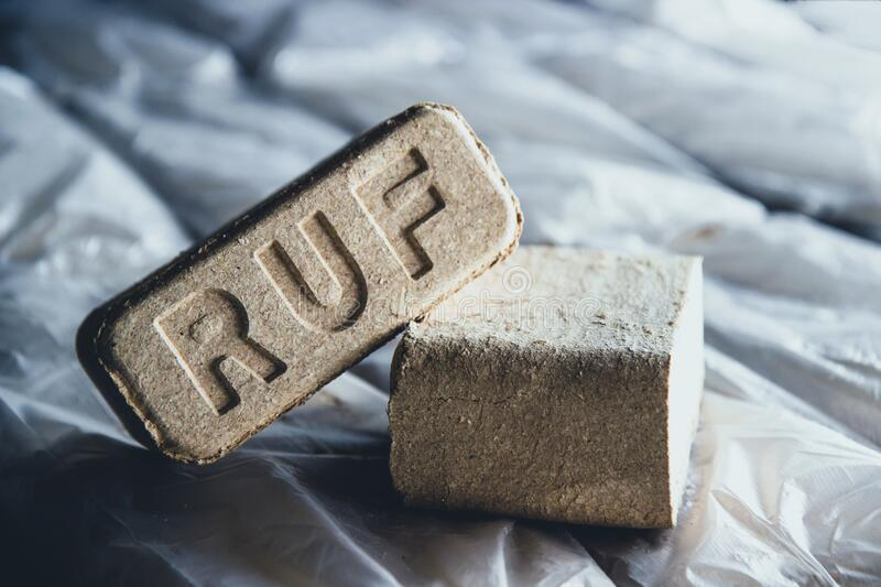 Alternative fuel, eco fuel, bio fuel. Wood sawdust briquettes for stoves. Lean-burn with good heat output.  royalty free stock images