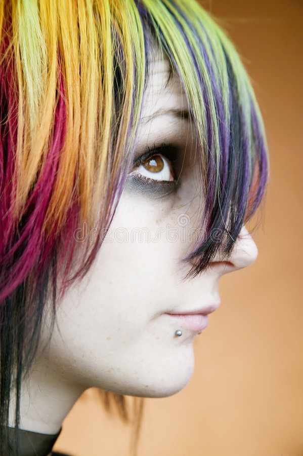 Alternative girl with multi-colred hair looks up royalty free stock photography