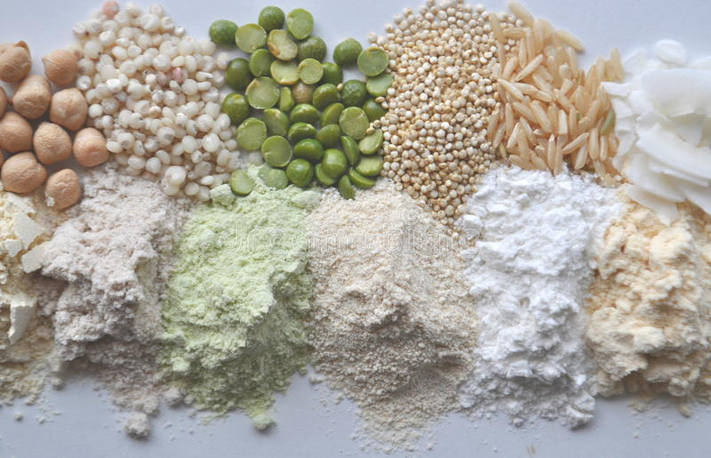 Alternative gluten-free flour, grains and legumes - teff, amaranth, corn, chickpeas, sorghum, green peas, quinoa, rice, coc. Alternative gluten-free flour royalty free stock images