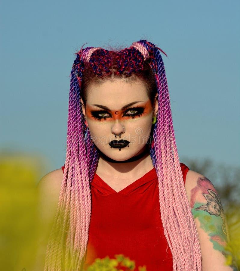 Gothic girl, tattoo`s braided hair,eye make-up stock photos