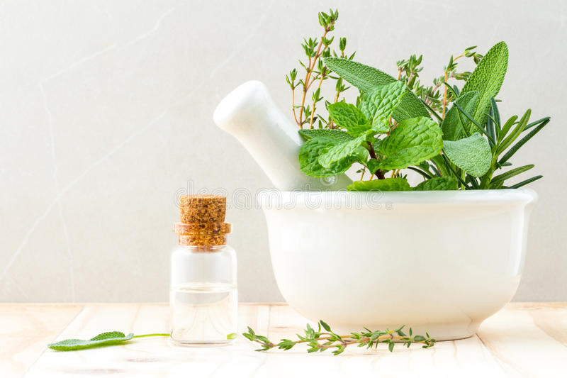 Alternative health care fresh herbal and Bottle of aromatherapy royalty free stock image