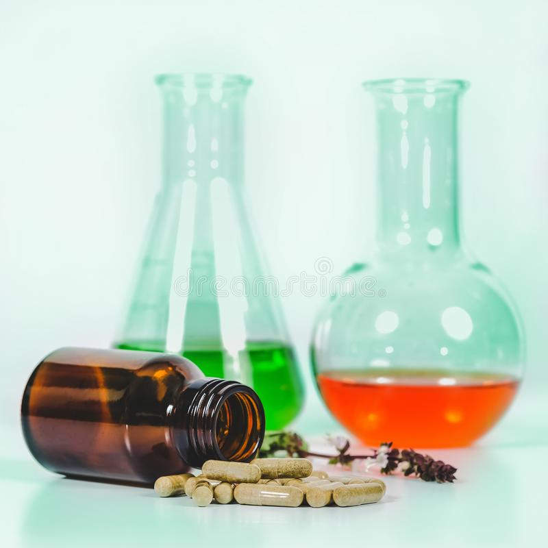 Alternative herb capsule spill out of bottle ,health. Concept stock image