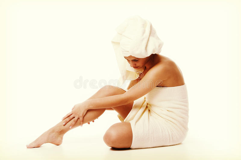 Alternative medicine and body treatment concept. Atractive young woman after shower with towel. stock images