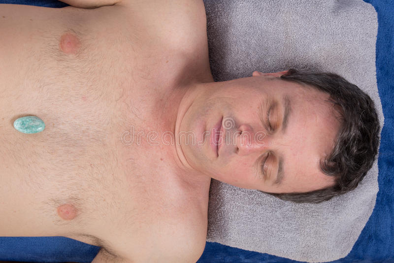 Alternative medicine, therapist using gemstones for lithotherapy stock image