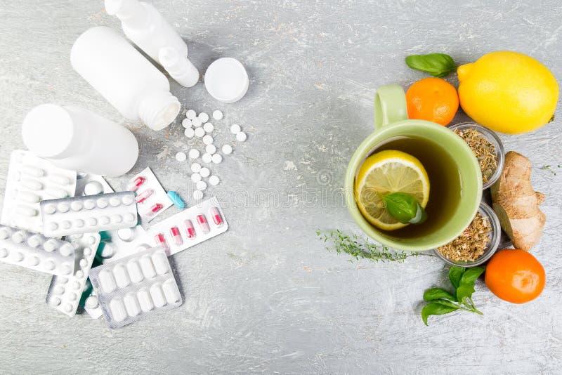 Natural medicine vs conventional medicine concept. Alternative remedies and traditional pills to treat colds and flu. Natural medicine vs conventional medicine stock photos