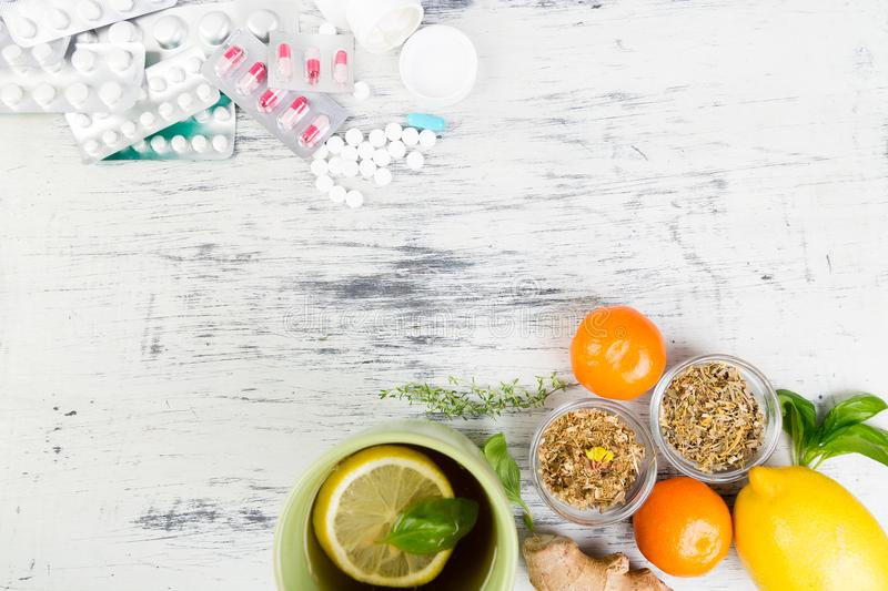 Natural medicine vs conventional medicine concept. Alternative remedies and traditional pills to treat colds and flu. Natural medicine vs conventional medicine royalty free stock image