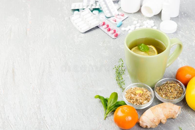 Natural medicine vs conventional medicine concept. Alternative remedies and traditional pills to treat colds and flu. Natural medicine vs conventional medicine stock photography