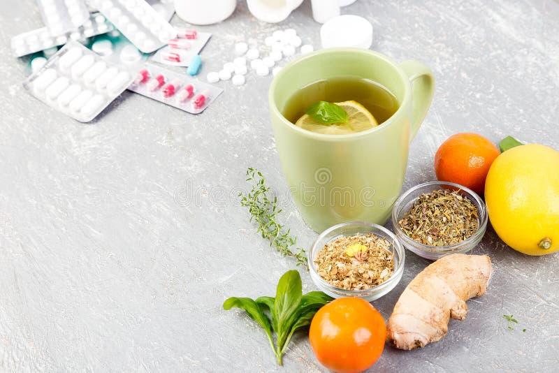 Natural medicine vs conventional medicine concept. Alternative remedies and traditional pills to treat colds and flu. Natural medicine vs conventional medicine royalty free stock photos