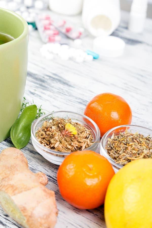 Natural medicine vs conventional medicine concept. Alternative remedies and traditional pills to treat colds and flu. Natural medicine vs conventional medicine stock photo