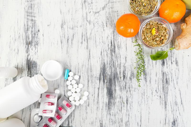 Natural medicine vs conventional medicine concept. Alternative remedies and traditional pills to treat colds and flu. Natural medicine vs conventional medicine royalty free stock photography