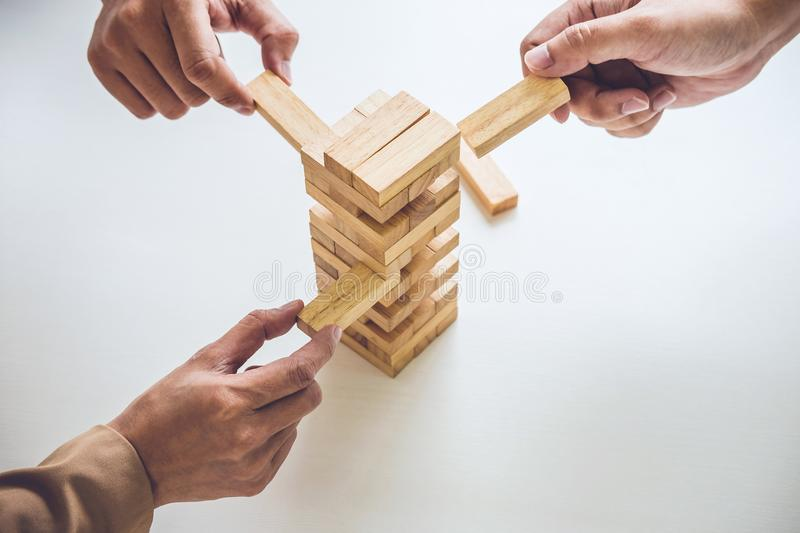 Alternative risk plan and strategy in business, Young intelligent business team playing the wood game, hands of executive royalty free stock image