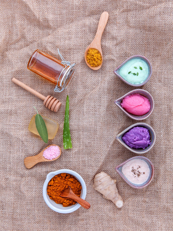 Alternative skin care and homemade scrubs with natural ingredients sage ,turmeric ,sea salt ,honey, aloe stock image