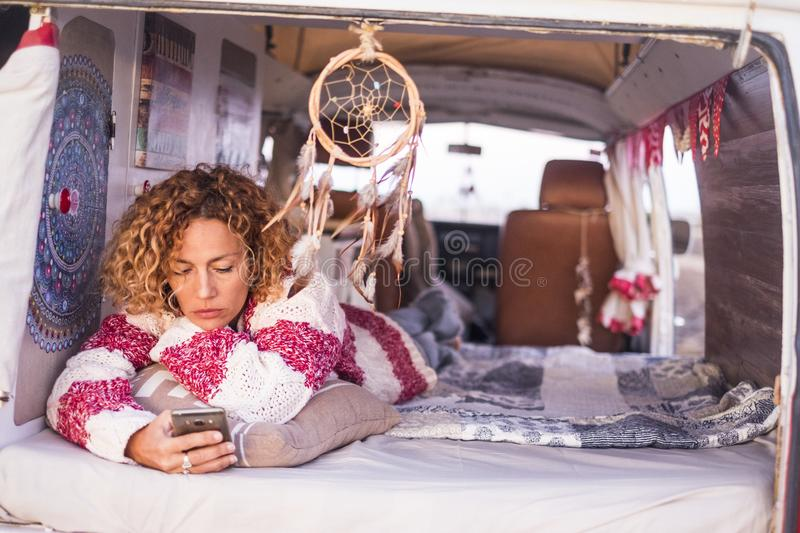 Beautiful young woman caucasian in leisure activity with a old van in vacation stock photos