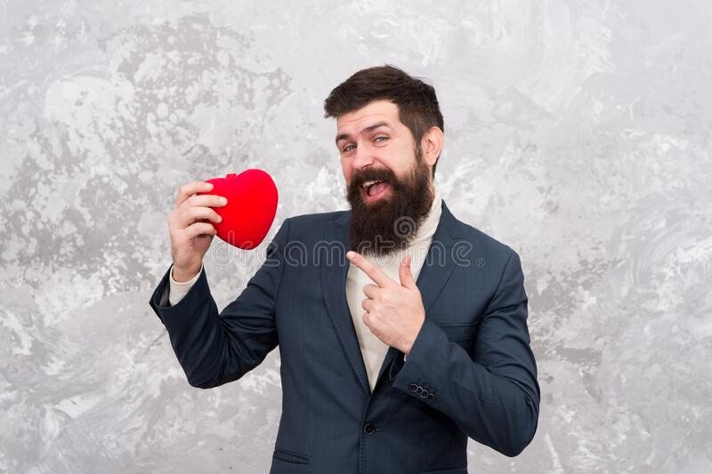 Alternative Valentines day. Bearded man point finger at red heart. Heart transplantation. Red life. Blood donation stock images