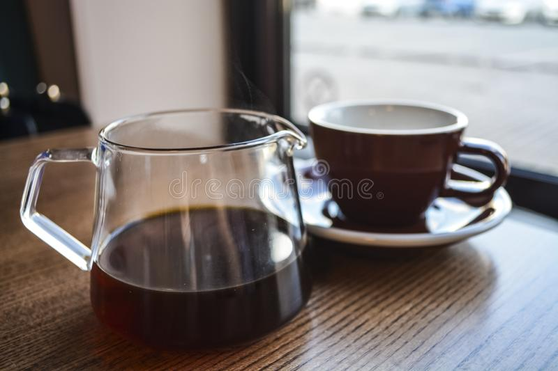 Alternative way of preparation of coffee. The invigorating morning strong drink in the server and a cup. Coffee shop. Alternative way of preparation of coffee stock photography