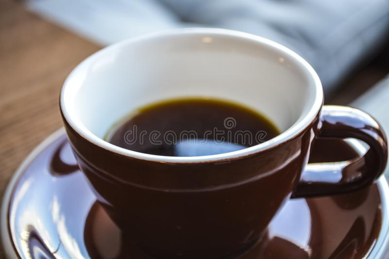 Alternative way of preparation of coffee. The invigorating morning strong drink in the server and a cup. Coffee shop. Alternative way of preparation of coffee stock image