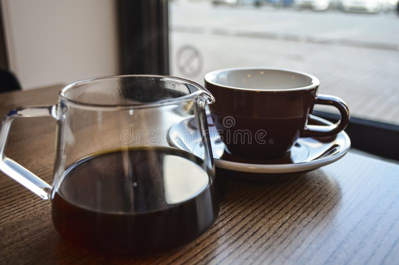 Alternative way of preparation of coffee. The invigorating morning strong drink in the server and a cup. Coffee shop. Alternative way of preparation of coffee stock photo