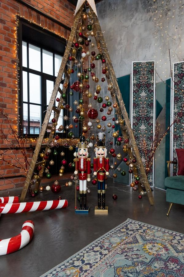 Alternative wooden christmas tree. A handmade New Year tree with light garland. Loft style, modern interior. Copy space stock image