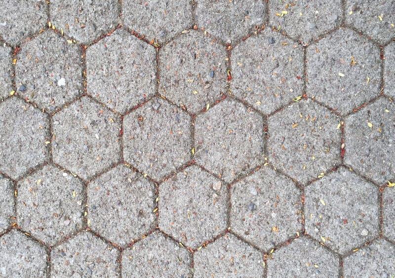 Altes Betonblockmuster des Hexagons des Bodens stockbild