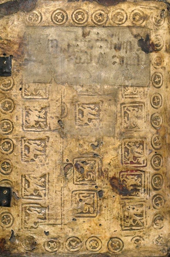 Altes Buch-mittelalterlicher Text - Grungy Hintergrund lizenzfreie stockfotos