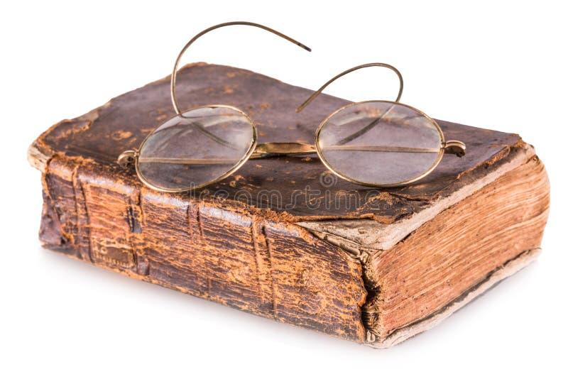 Altes Buch und Gläser stockbild