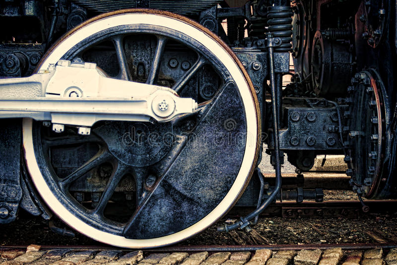 Altes Dampf-Lokomotive-Weinlese-Antriebsrad Grunge lizenzfreie stockbilder