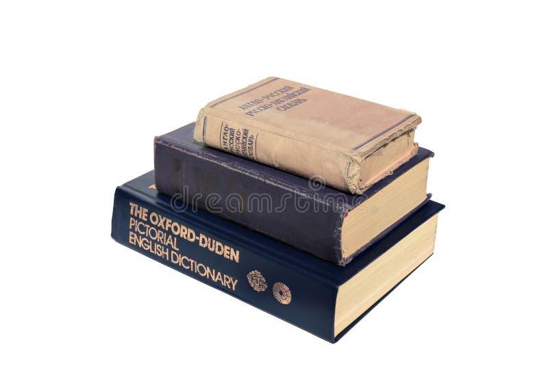 Altes englisches Wörterbuch drei lokalisiert lizenzfreie stockfotos