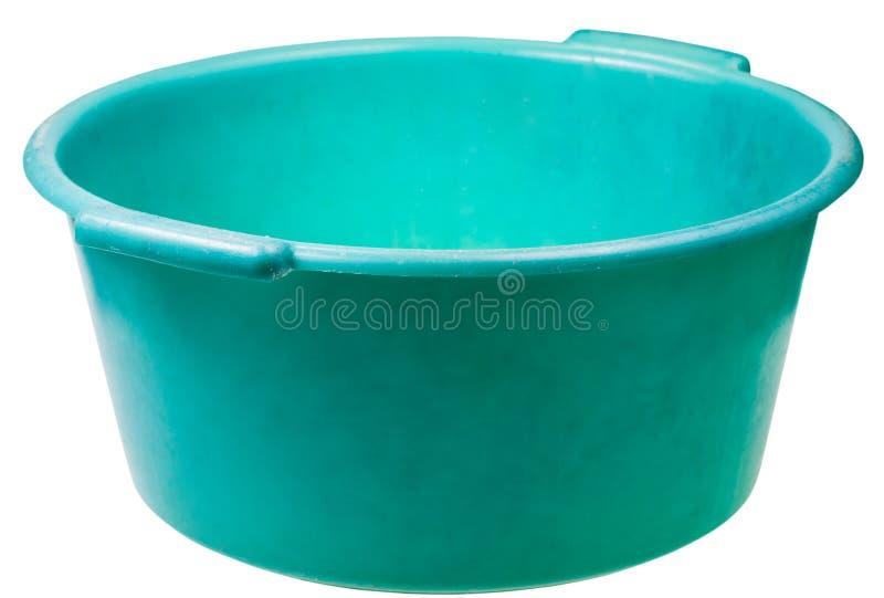 Altes grünes rundes PlastikWaschbecken lokalisiert lizenzfreie stockfotos