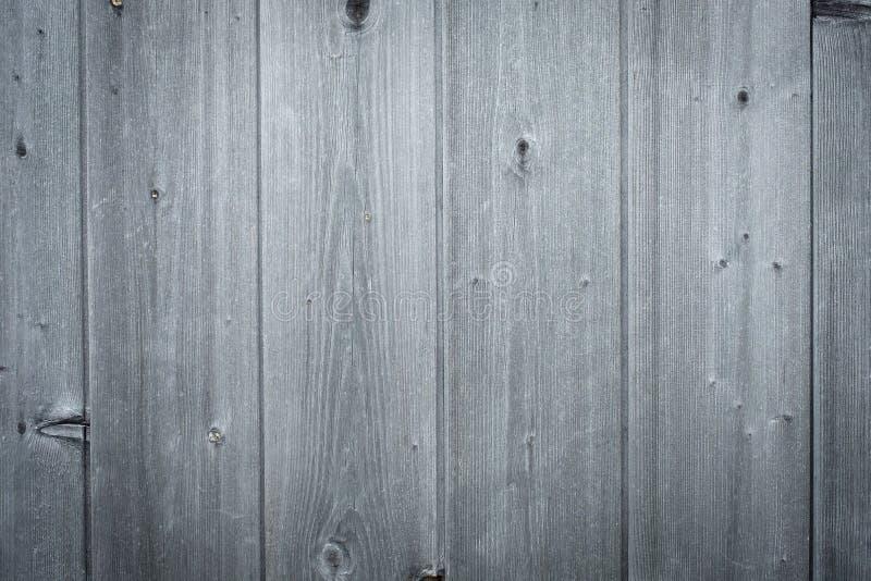 Altes Grau verwitterte hölzerne Bretter mit Kopienraum stockfotos