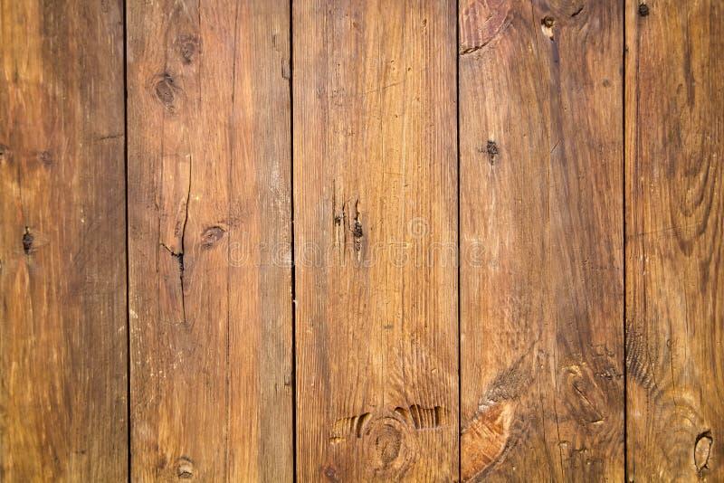 Altes Holz zu einem Wandhintergrund stockbild