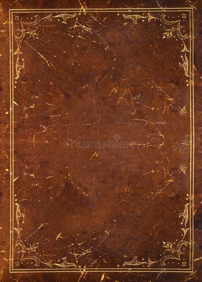 Altes Leder mit goldener Dekoration stockfotos