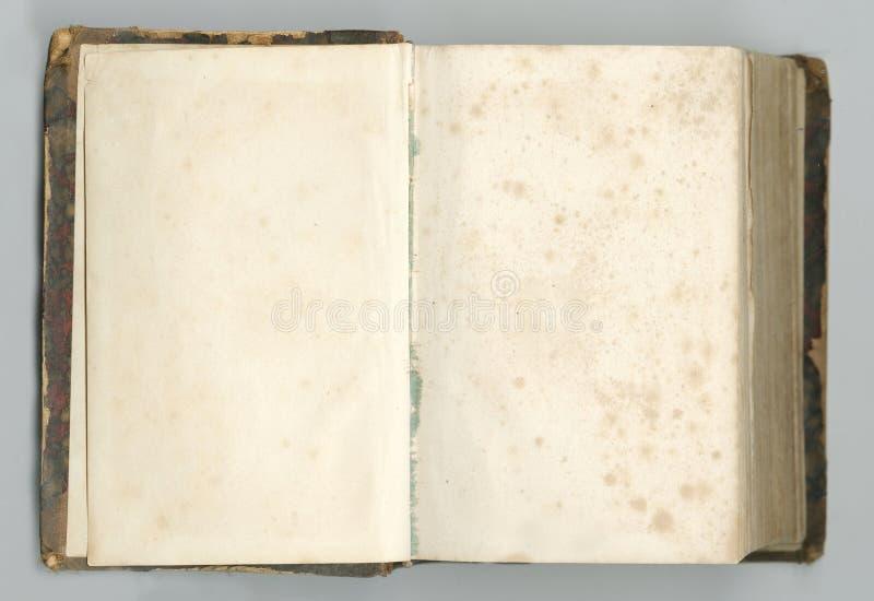 Altes offenes Notizbuch mit gelb gefärbten Seiten stockbild